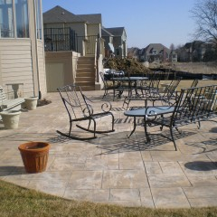 Majestic Ashlar Patio with Steps and Elevated Concrete Deck